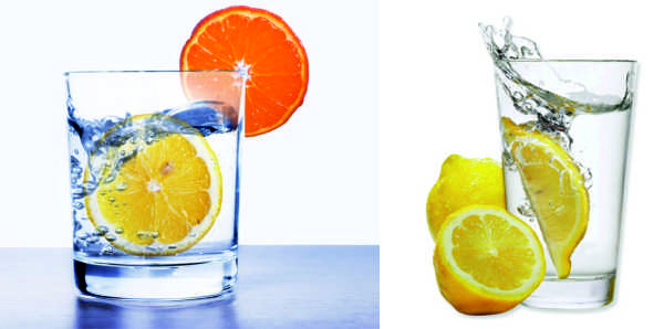 Стаканы с лимонной и апельсиновой водой